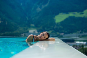 Relaxing swimming pool in front an beautiful landscape